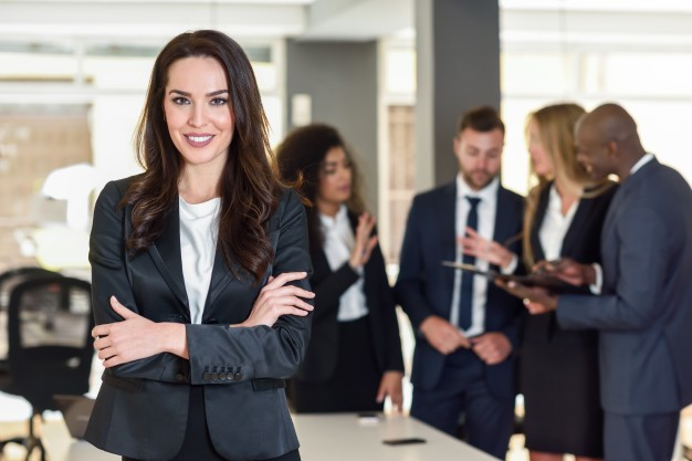 businesswoman-leader-modern-office-with-businesspeople-workin_1139-954